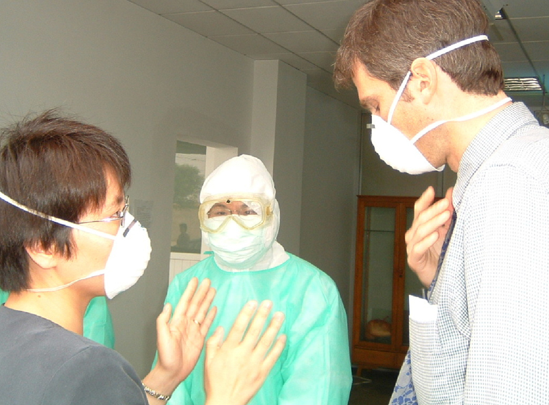 Several physicians are wearing masks in this image to prevent the spread of SARS.