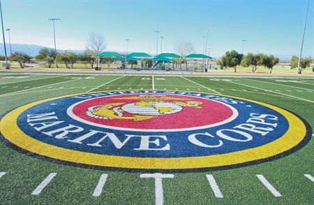 The Marine Corps seal is shown on a field.