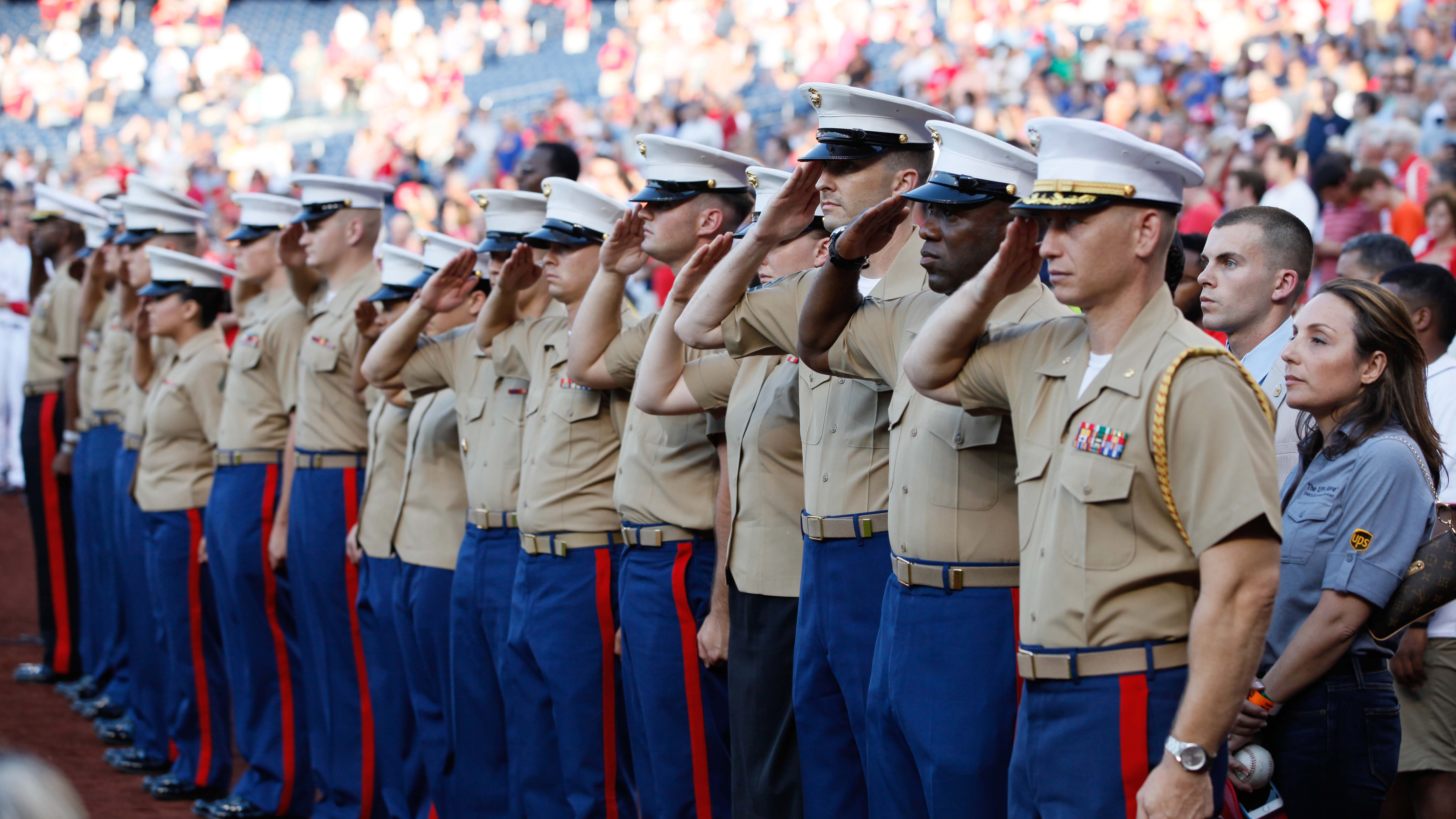 Marines stand at attention during a Nats game.