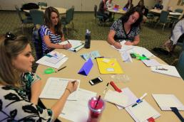 A group of volunteers participate in family readiness training in this image.