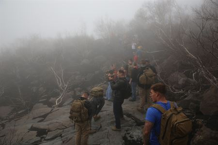 Backpackers are surrounded by volcanic smog in this image.