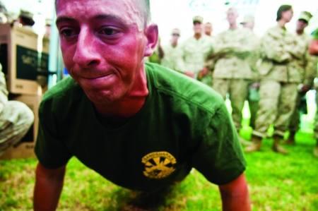 A Marine struggles while exercising during extreme heat conditions.