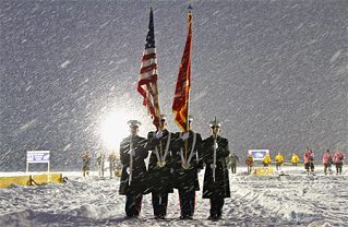 Marines present the colors during a snowstorm.